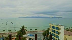 Upper View Tropical Resort City against Sea Boats Cloudy Sky. NHA TRANG, KHANH HOA/VIETNAM - OCTOBER 28 2016: Upper panorama of tropical resort city against sea stock footage