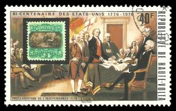 US Stamp and Declaration of Independence. Upper Volta - stamp 1975: Color edition on American Bicentennial Art, shows US Stamp and Declaration of Independence Royalty Free Stock Photo