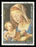 Virgin with Child by Albrecht Durer. Upper Volta - stamp 1973: Edition on Biblical motifs, shows Painting Virgin with Child by Albrecht Durer Royalty Free Stock Images