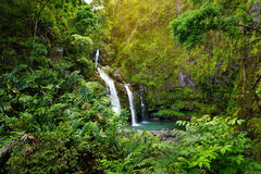 Upper Waikani Falls also known as Three Bears, a trio of large waterfalls amid rocks & lush vegetation with a popular swimming hol Stock Image