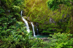 Upper Waikani Falls also known as Three Bears, a trio of large waterfalls amid rocks & lush vegetation with a popular swimming hol Royalty Free Stock Photography