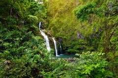 Upper Waikani Falls also known as Three Bears, a trio of large waterfalls amid rocks & lush vegetation with a popular swimming hol Royalty Free Stock Photo