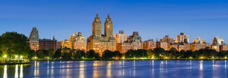 Upper West Side buildings at dawn and Central Park Reservoir. New York City. Panoramic view of Central Park West at dawn and the Jacqueline Kennedy Onassis Royalty Free Stock Photo