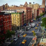 Upper west side NYC view. View from airbnb of a upper west side neighborhood with yellow taxis in Manhattan Royalty Free Stock Photography