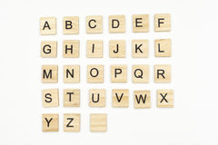 Uppercase alphabet letters on scrabble wooden blocks Stock Photo