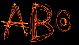 Uppercase laser alphabet - capital letter a b and at Stock Photography