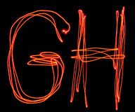 Uppercase laser alphabet - capital letter g and h Stock Photos