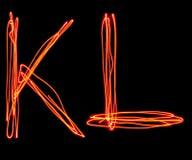 Uppercase laser alphabet - capital letter k and l Stock Photo