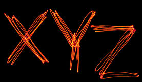 Uppercase laser alphabet - capital letter x, y and z Stock Photo