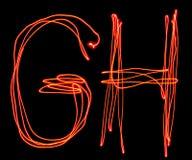 Uppercase laserowy abecadło - kapitałowy list g i h Zdjęcia Stock