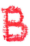 Uppercase lipstick alphabet - capital letter B. Isolated uppercase letter B made of red lipstick with fabric texture Royalty Free Stock Photography