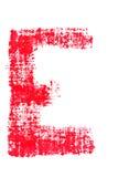 Uppercase lipstick alphabet - capital letter E. Isolated uppercase letter E made of red lipstick with fabric texture Royalty Free Stock Photos