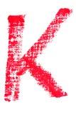 Uppercase lipstick alphabet - capital letter K. Isolated uppercase letter K made of red lipstick with fabric texture Royalty Free Stock Photos