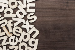 Uppercase and lowercase wooden letters background. On the table Stock Photo