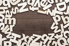 Uppercase and lowercase wooden letters background. On the table Stock Image