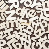 Uppercase and lowercase wooden letters background. On the table Royalty Free Stock Images