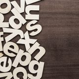 Uppercase and lowercase wooden letters background Royalty Free Stock Images