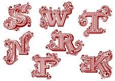 Uppercase röda blom- bokstäver för tappning Arkivfoto