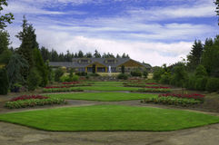 Upperclass front yard. A large house with a fountain in front, and several cut grass yards Royalty Free Stock Photos