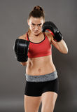 Uppercut from kickbox girl Stock Photos