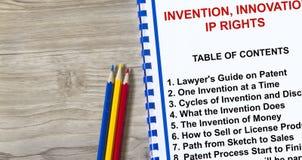 Uppfinning-, innovation- och immateriell rättigheträttbegrepp royaltyfri bild