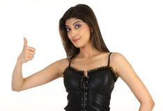 uppgiftsflicka henne som visar tonårs- framgång Arkivfoto
