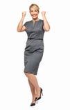 Upphetsad affärskvinna Clenching Fists Fotografering för Bildbyråer