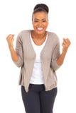 Upphetsad afro amerikansk kvinna Arkivbild