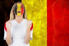 Upphetsad Belgien fan i framsidamålarfärgbifall Royaltyfri Foto