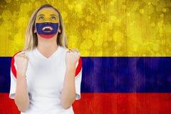 Upphetsad Colombia fan i framsidamålarfärgbifall Royaltyfri Fotografi