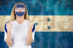 Upphetsad Honduras fan i framsidamålarfärgbifall Arkivfoto