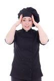 Upphetsad kockkvinna i den svarta likformign som isoleras på vit Royaltyfri Fotografi