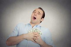 Upphetsad lyckad affärsman som är förälskad med pengar Royaltyfria Bilder