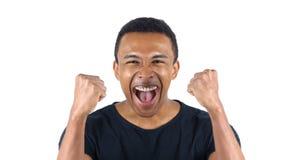 Upphetsad svart man som firar hans framgång Royaltyfri Bild