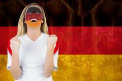 Upphetsad tysk fan i framsidamålarfärgbifall Fotografering för Bildbyråer
