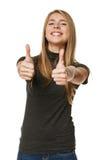 Upphetsad ung framgångkvinna som ger upp tum Royaltyfri Fotografi