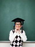 Upphetsad ung kvinnlig nerd som är blyg och Arkivbilder