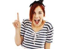 Upphetsad utvikningsbildstilkvinna med fingret Arkivbild