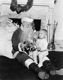 Upphetsat barn med Santa Claus (alla visade personer inte är längre uppehälle, och inget gods finns Leverantörgarantier som där w Arkivfoto