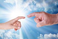 Uppkomst - bibel - skapelse - fader & son Arkivbild