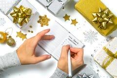 Upplösningar för nytt år - framställning av listan av upplösningar arkivbild