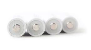 Uppladdningsbara AA-batterier på vitbakgrund Royaltyfri Bild