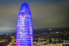 Upplyst Agbar torn och stad av Barcelona, Spanien Fotografering för Bildbyråer