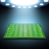 Upplyst fotbollfält för ljusa strålkastare royaltyfri illustrationer