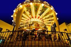 Upplyst retro karusell på natten Arkivfoto