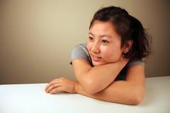 Uppnosig asiatisk flicka Arkivbilder