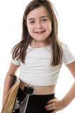Uppnosig ung flicka med skateboarden Royaltyfria Bilder