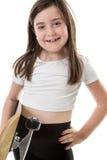 Uppnosig ung flicka med skateboarden Royaltyfri Foto