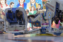 Uppochnervända besökare på karusell på Oktoberfest, Stuttgart Royaltyfri Foto