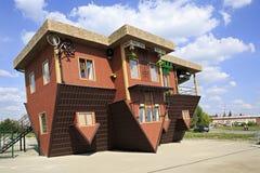 Uppochnervänt hus för dragning Fotografering för Bildbyråer